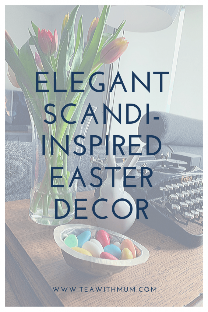 Elegant Scandi-inspired Easter decor: easy DIY wire egg crowns, colourful graphic watercolor art, vintage chocolate moulds, Danish design Easter bunnies and fresh flowers; How to give your Easter decor a scandi vibe on the cheap