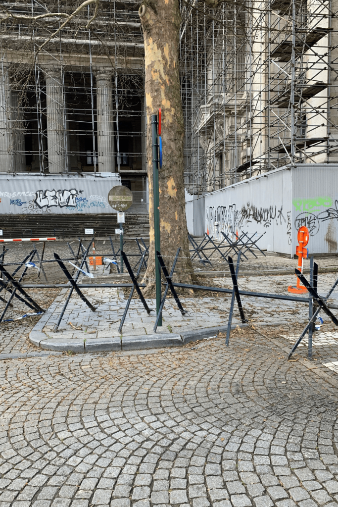 Barbed wire and construction on the Palais du Justice at Place Poelaerts