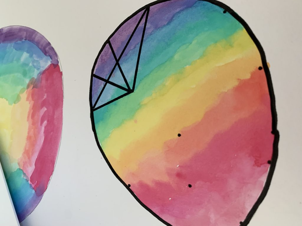 Eye-catching graphic watercolour Easter art: adding the graphic elements. First outline the shape, then add intersections and connect the intersections together.