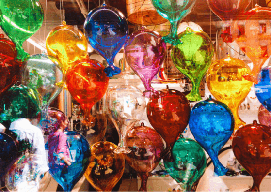 Glass balloons in Murano, Venice with a small child