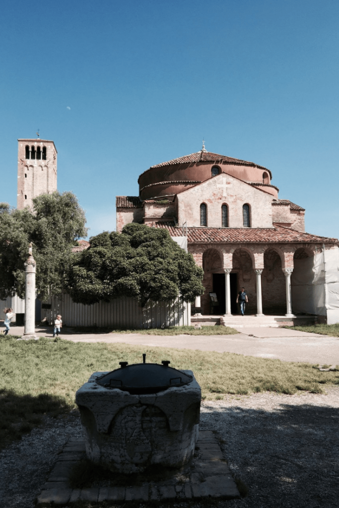 Santa Fosca, Torcello with a small child