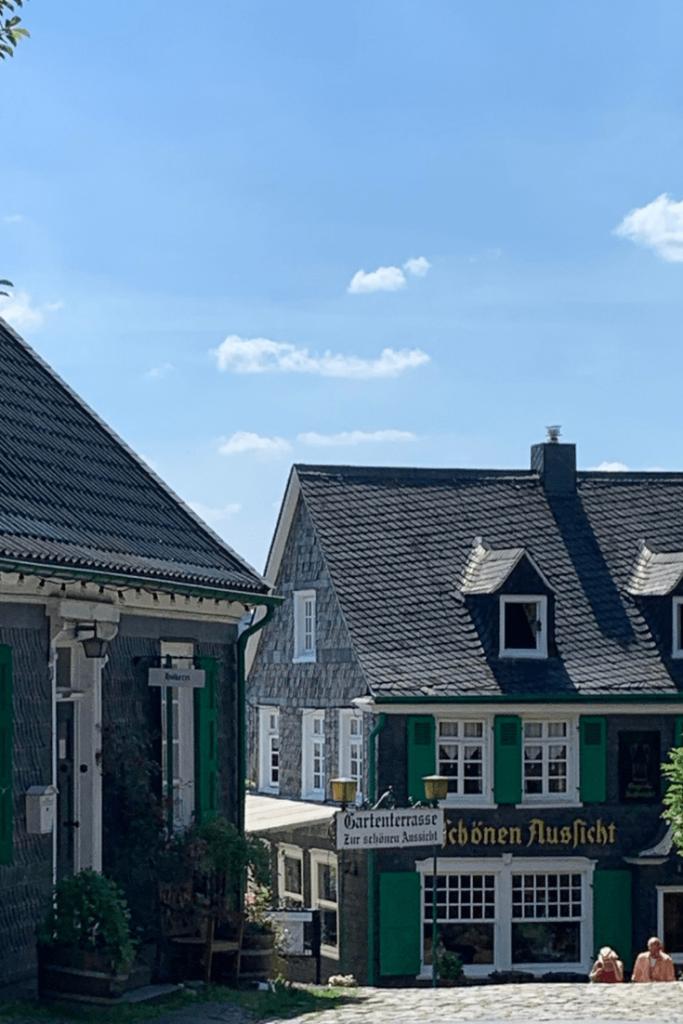 View towards the restaurants on Schlossplatz, Burg Castle in Solingen