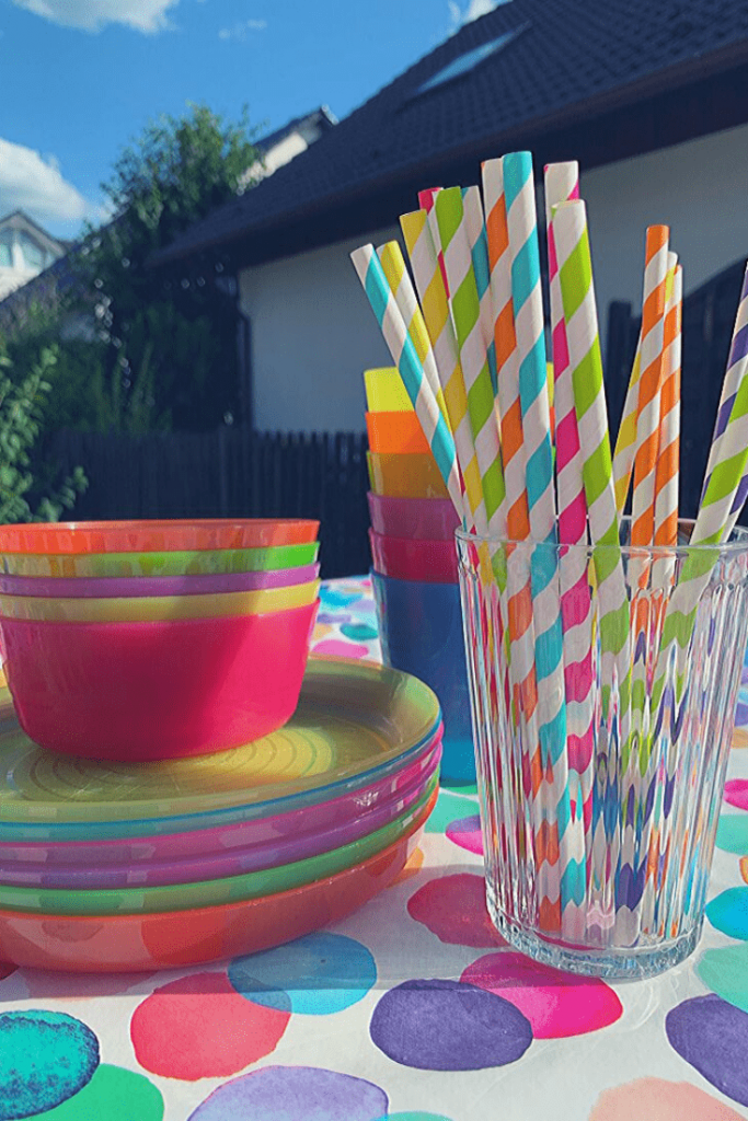 Bright plates and straws are an easy way to make a dinosaur-themed birthday party more girly