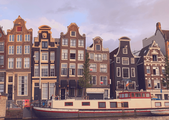 Drunken houses, as viewed from the boat tour, the first point on our itinerary for 48 hours in Amsterdam with kids