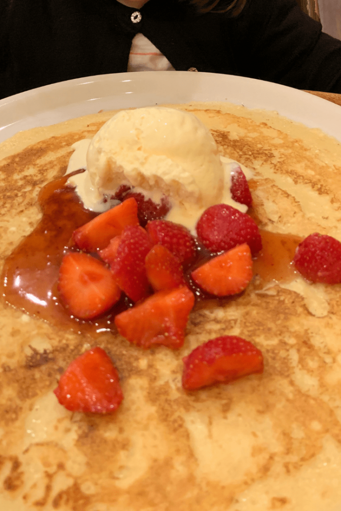 Huge Dutch pancake with fresh strawberries and ice cream in Amsterdam