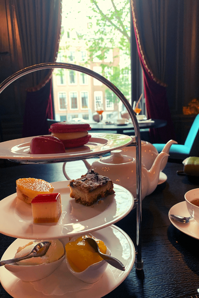 Afternoon tea at the Handbag and Purse Museum in Amsterdam; scones and clotted cream and small cakes overlooking the canal
