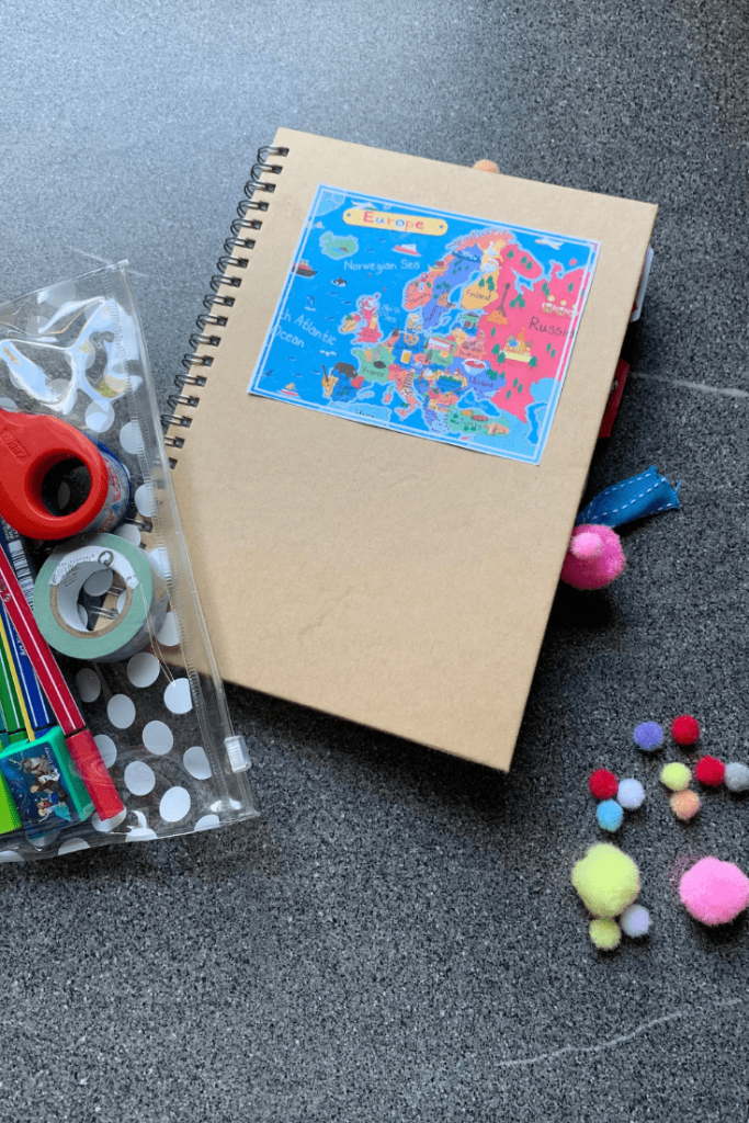 Miss M's travel journal and travel pencil case and leftover pompoms.