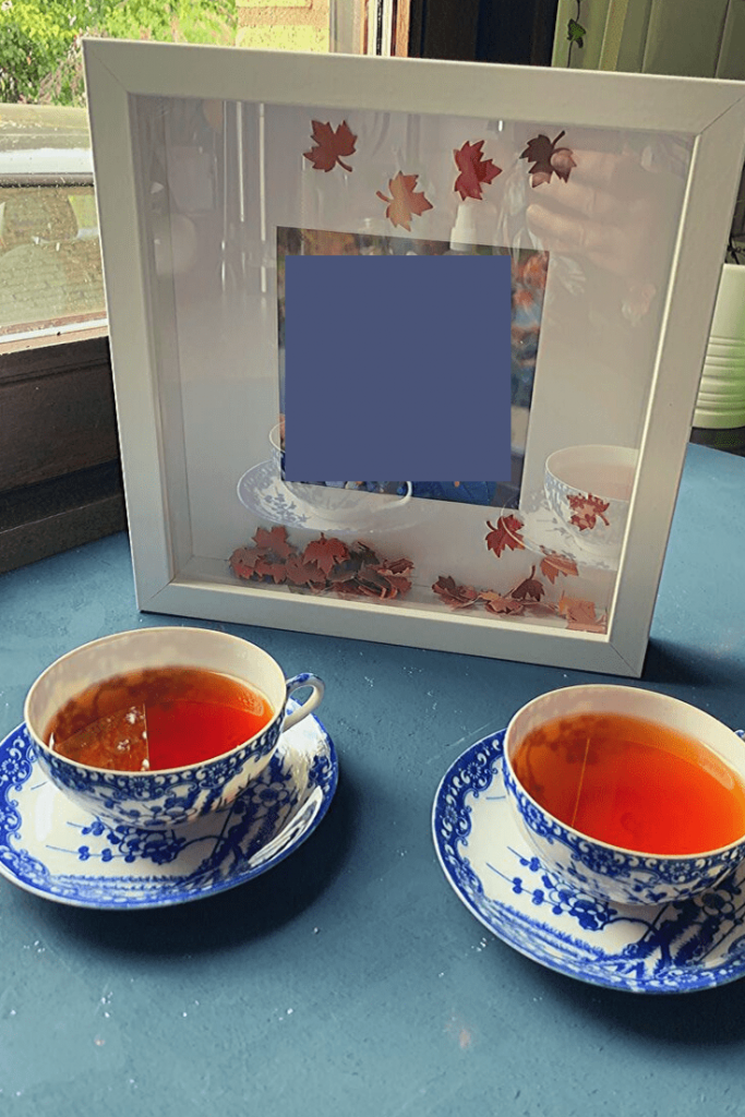 Easy DIY Autumn 'art': step 5 and 6: add the leaves and photo and enjoy; how to create a Fall picture frame 'snowglobe'