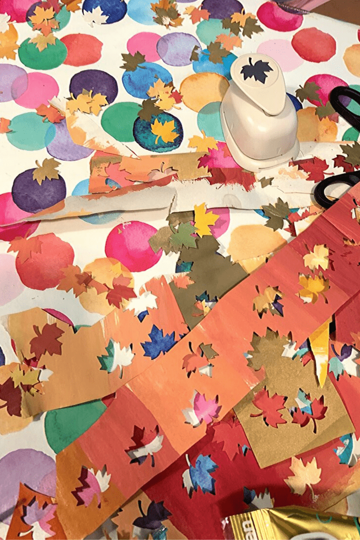 Easy DIY Autumn 'art': step 2: punch out the leaves; how to create a Fall picture frame 'snowglobe'