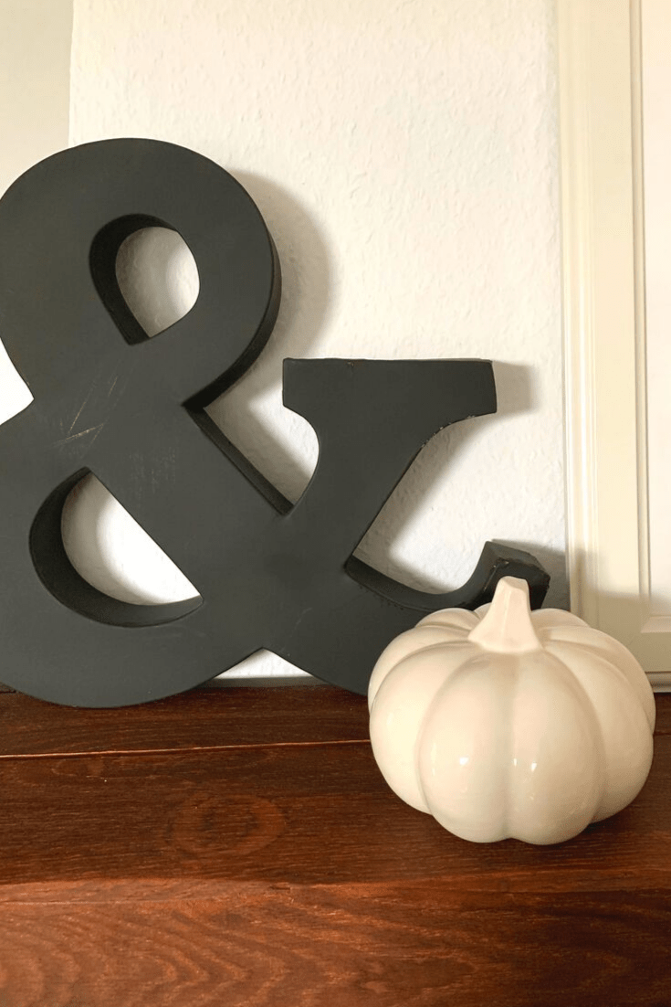 Fall mantle: left side. With large metal ampersand and white, porcelain pumpkin