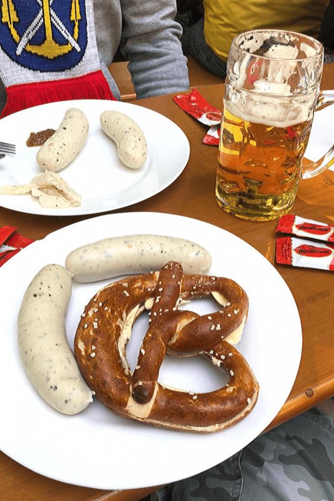 Weisswurst, sweet mustard, brezel and beer: a traditional Bavarian breakfast at the Viktualienmarkt.