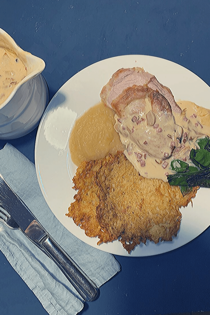 Reibekuchen, or German potato pancakes served with roast pork, apple sauce, sautéed snow peas and a creamy sauce with oyster mushrooms and bacon.