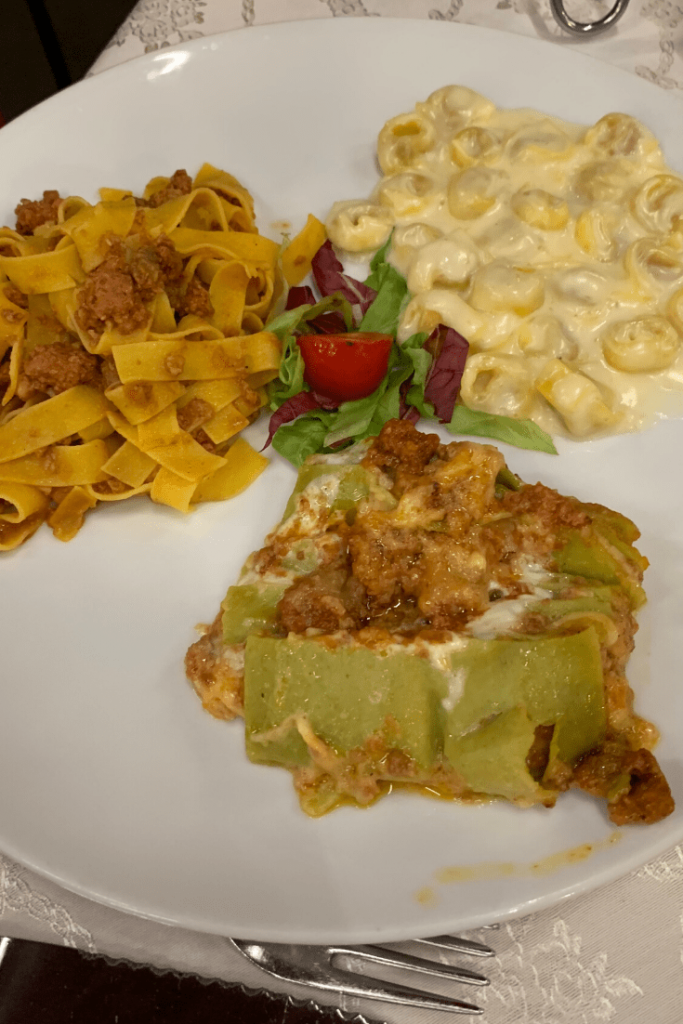 Trio of traditional bolognese pastas: tortellini, tagliatelle with ragu and lasagne bolognese; what to do in Bologna with kids - try the food!