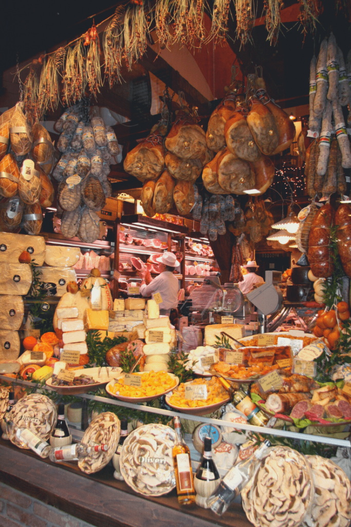 Shop selling traditional food from the Emilia Romagna; Take a food tour or a cooking class; What to do in Bologna with kids
