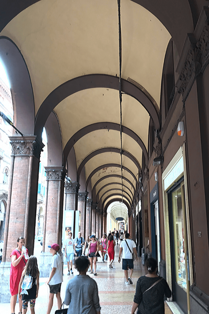Some of the many kilometers of porticoes in Bologna; what to do in Bologna with kids - go for a stroll under the porticoes.