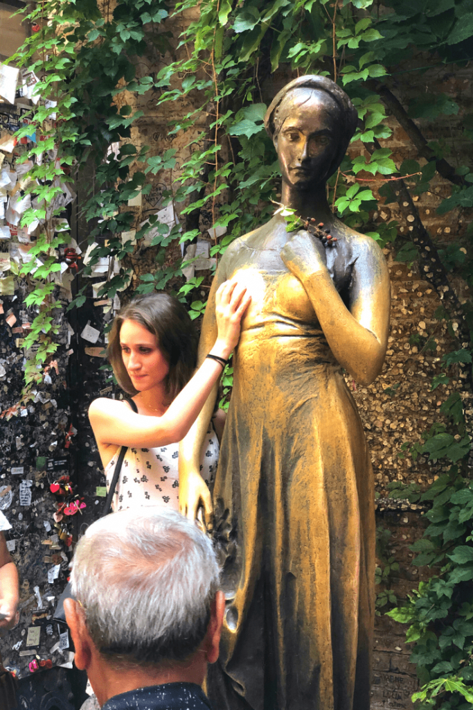 What to do in Verona with kids: Bronze statue of Juliet at Juliet's house, rub it for luck in love; what to do in the north of Italy with kids; the Romeo and Juliet trail