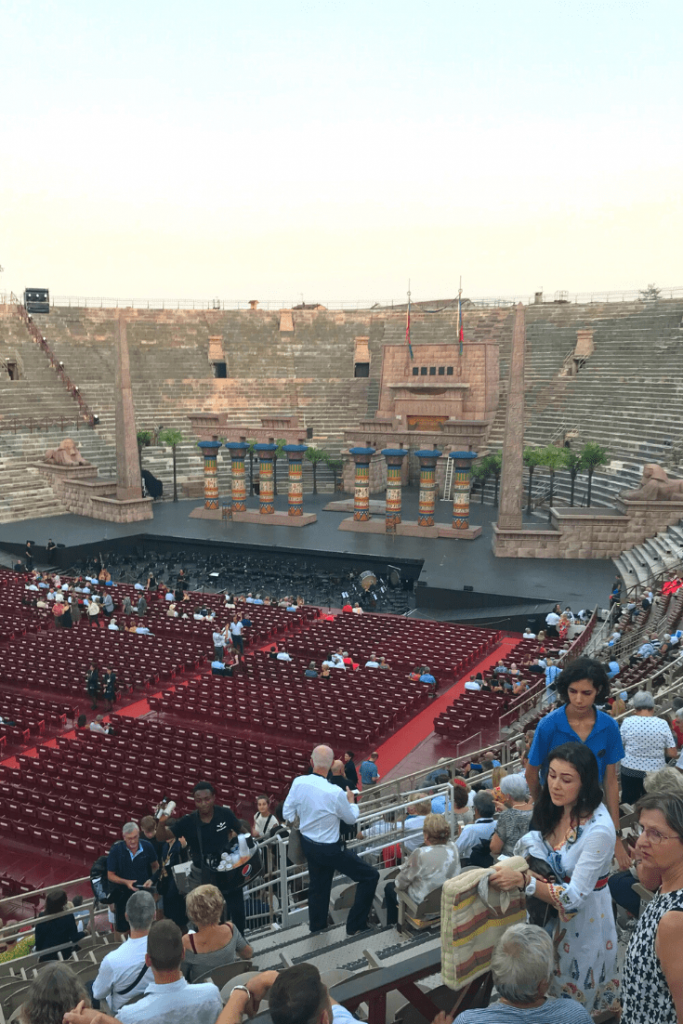 The Arena is slowly filling with people waiting to watch a performance of the opera Aida.