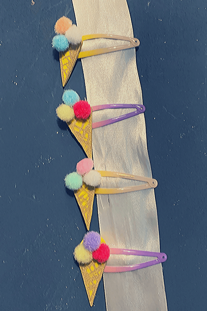 Ice cream hair clips clipped to a white ribbon; DIY gifts for a young girl; simple, quick and fun