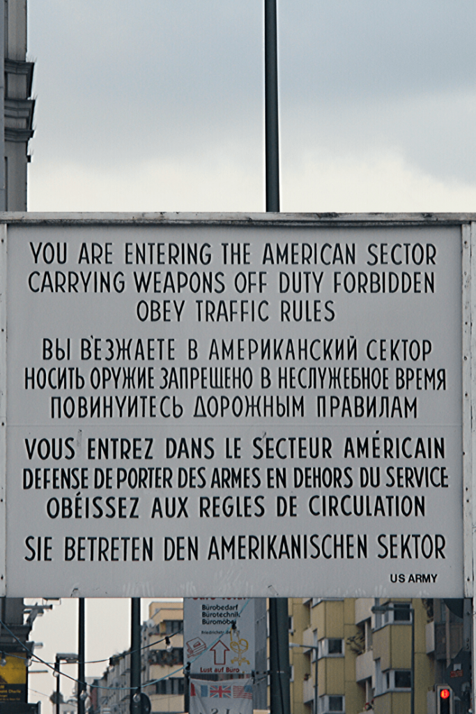 Warning sign at Checkpoint Charlie, one of the most important border crossings in the Berlin Wall; 30th anniversary of the fall of the Berlin Wall