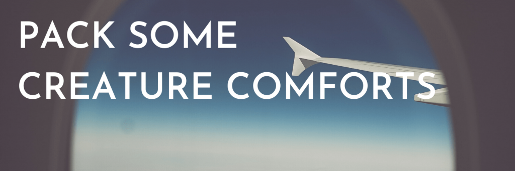 Our fourth tip when travelling for the holidays: Pack some creature comforts. If possible, pack some creature comforts in your hand luggage. These will make your flight and any time spent waiting at the airport due to delays much more comfortable. Picture from a plane seat, through a window over the clouds; Photo by Toa Heftiba on Unsplash