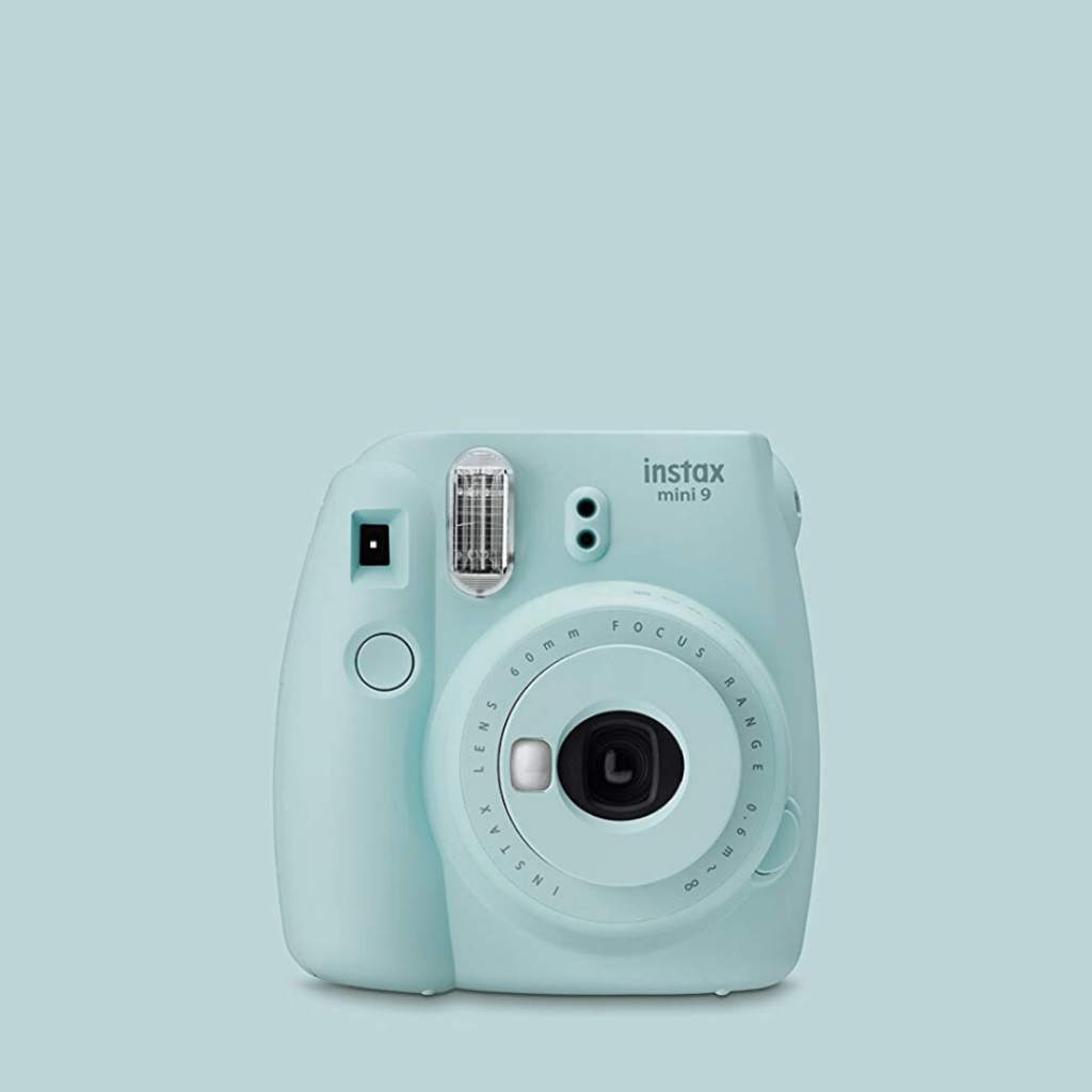 Pale blue polaroid Instax camera, the perfect camera for some fun holiday pics; fun gifts for tween travellers