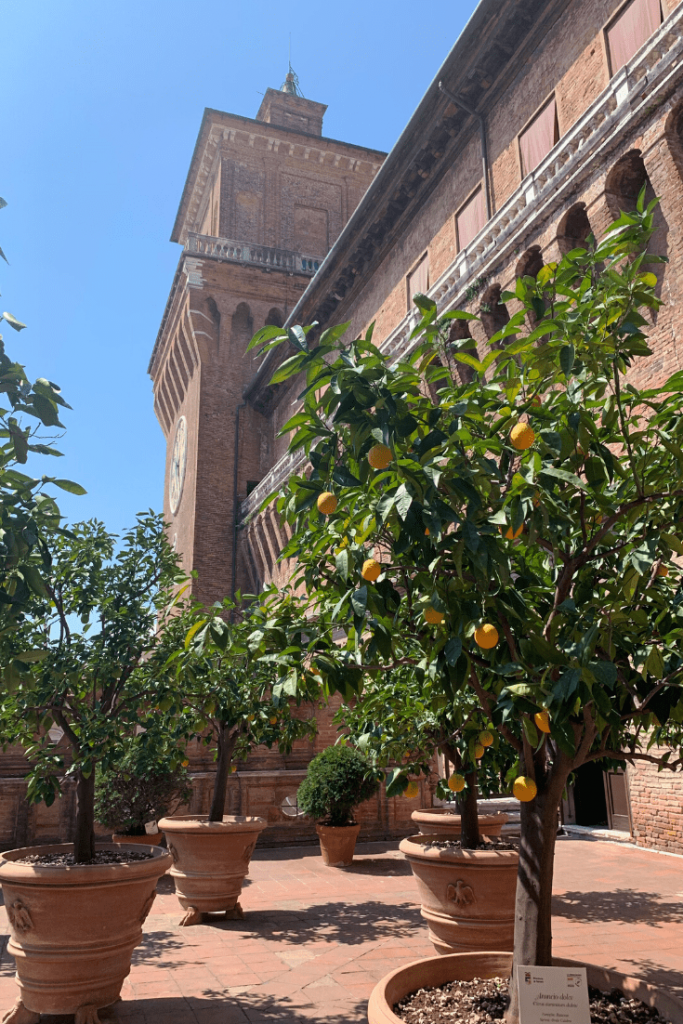 Estense Castle - Family home of the Dukes of Este - an imposing moat and drawbridge and towers and some interesting frescoes inside; best small Italian towns to visit in the north; view of the courtyard and castle