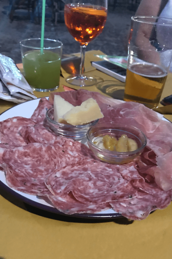 Traditional Mantovian snacks: air dried ham, parmesan cheese, mantovian salami and mantua mustard, which is quite sweet but delicious with the meat