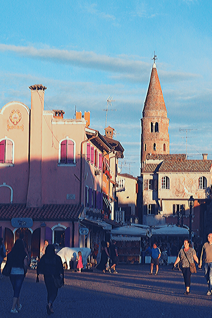 The colourful fishing village of Caorle on the Venetian Lagoon. With a colourful old town and great beaches, it is one of our insider tips of the best small towns to visit in the north of Italy.