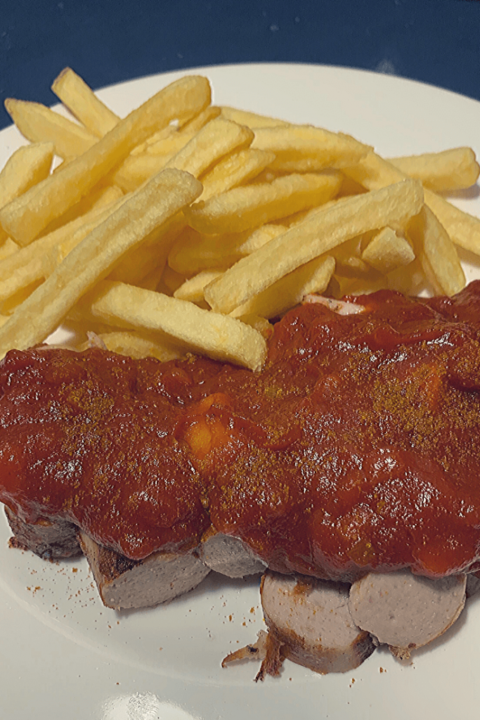 Berliner currywurst, served with fries; a simple, speedy and tasty recipe for this traditional German street food; our travel recipes; 30th anniversary of the fall of the Berlin Wall