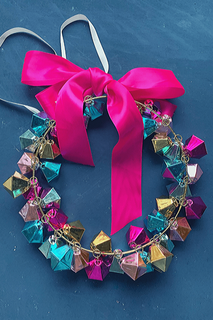 4 easy DIY Christmas wreaths that take under 30 minutes to make; a bell Christmas wreath made from a simple large Christmas ornament