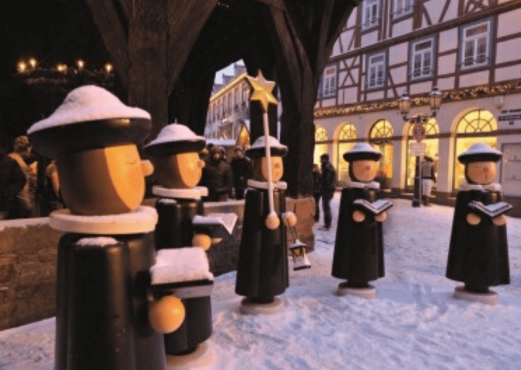Carolers carved out of wood by students at the local Technical Academy at the Michelstadt Christmas markets. These and other carvings are spaced throughout the market and make it one of the best German Christmas markets.