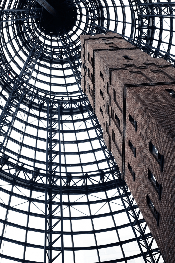 Number 10 of 13 fun things to do and see in Melbourne with kids: Go shopping at Melbourne Central - Take a break from the weather and admire the architecture of Melbourne Central. Look out for the clock Glockenspiel. Photo: Alex Knight on unsplash.
