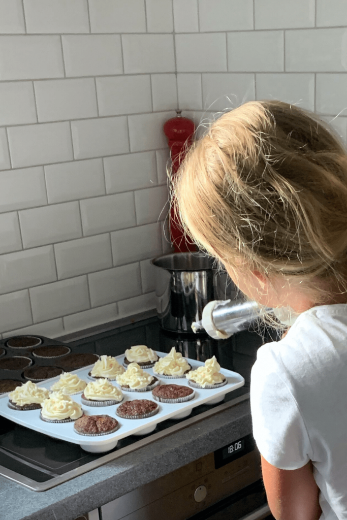 Our novice baker frosting these delicious and fun Oreo cupcakes with vanilla and white chocolate buttercream