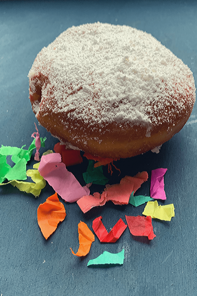 The fun side of Berliner doughnuts: Carnival. Here a fresh doughnut with confetti for carnival