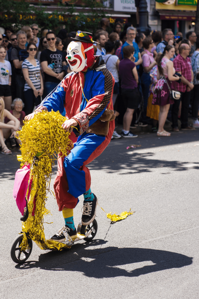 Helau! A clown on a bike during a carnival parade. Image:  Henry Addo on unsplash.