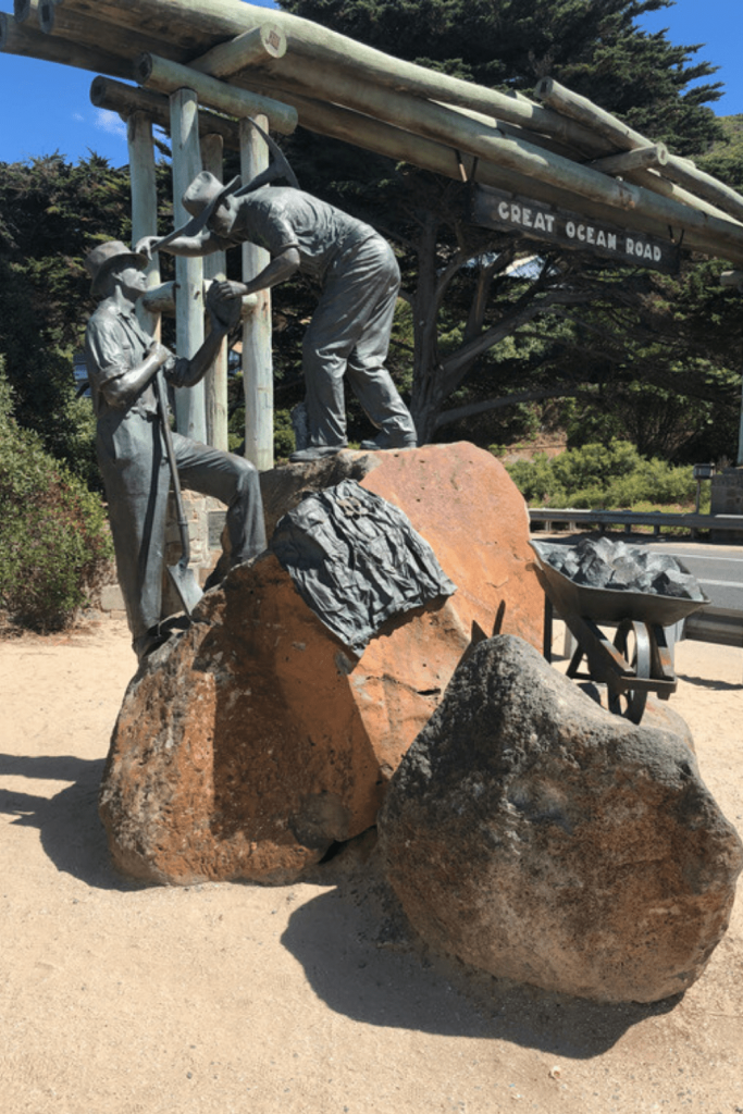 Statue and Great Ocean Road arch commemorating the building of the Road - reflecting on history