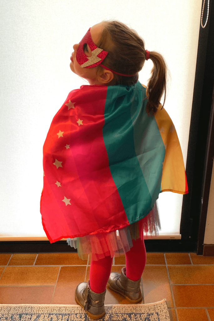 Super hero costume for a girl, with cape, mask and wrist bands from Accessorize.