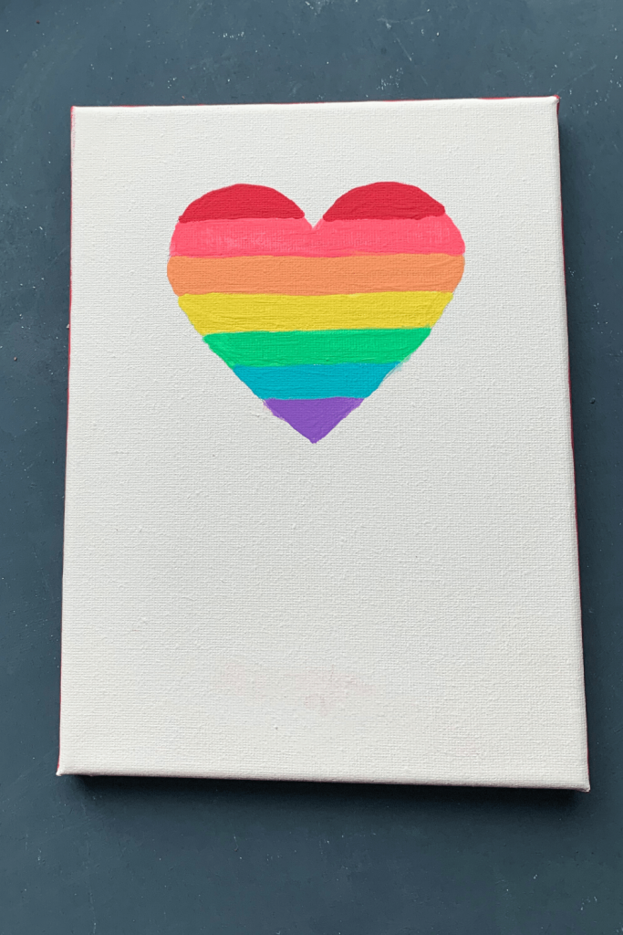 Simple Valentine's Day art; wedding anniversary artwork; love is in the air; rainbow stripes painted in a heart form on a white canvas