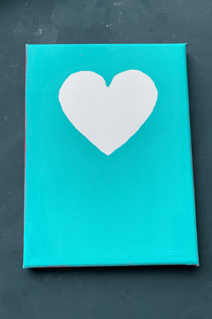 Simple Valentine's Day art; wedding anniversary artwork; White silhouette of heart on a pale blue background; paint on canvas