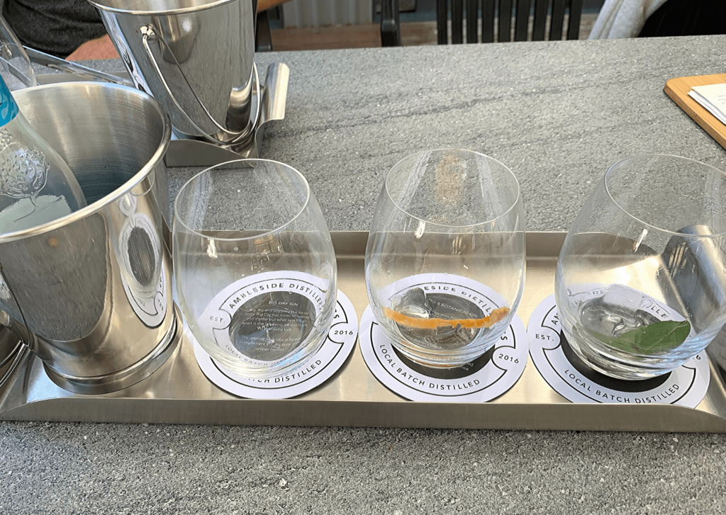 Gin tasting flight with three Ambleside Distillers gins and appropriate garnishes (well two garnishes, my brother pinched the other one)