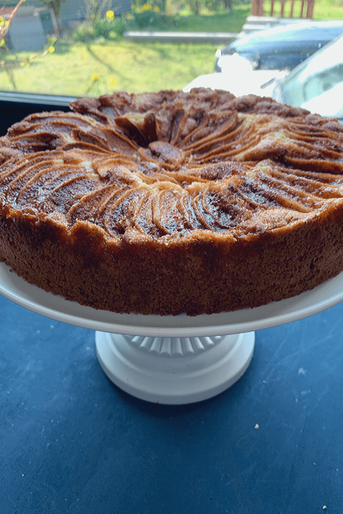 Mum's apple teacake, on a white cake stand