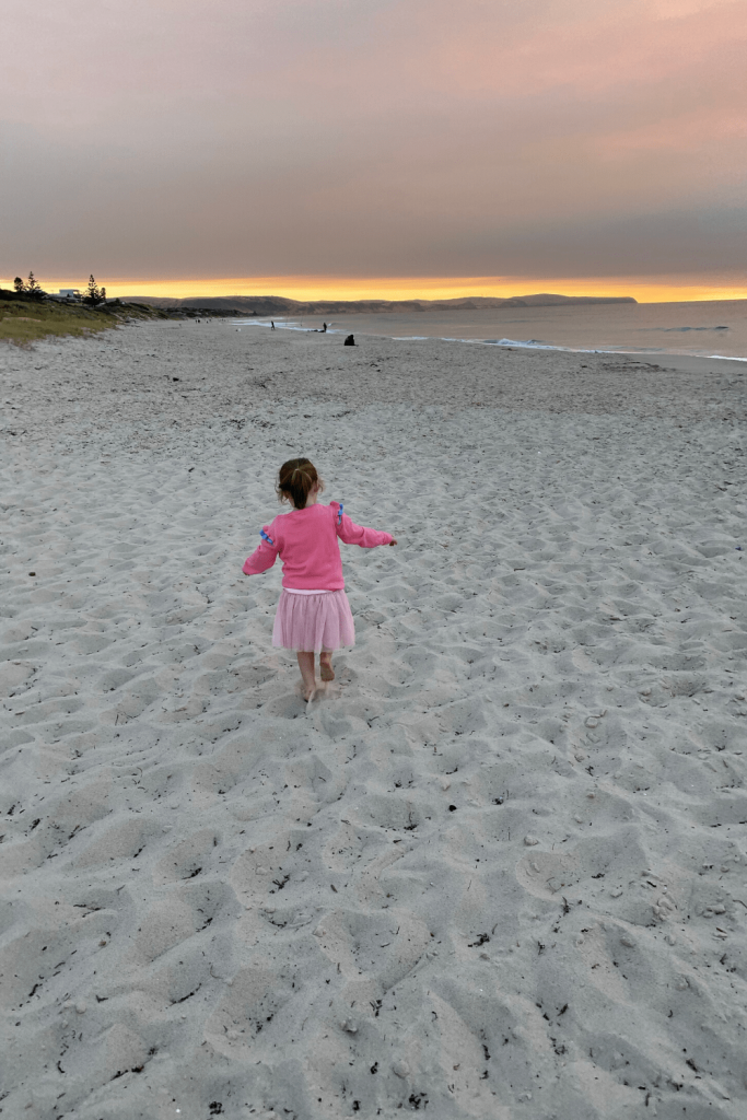 Playing on Carrickalinga Beach at sunset, Fleurieu Peninsula