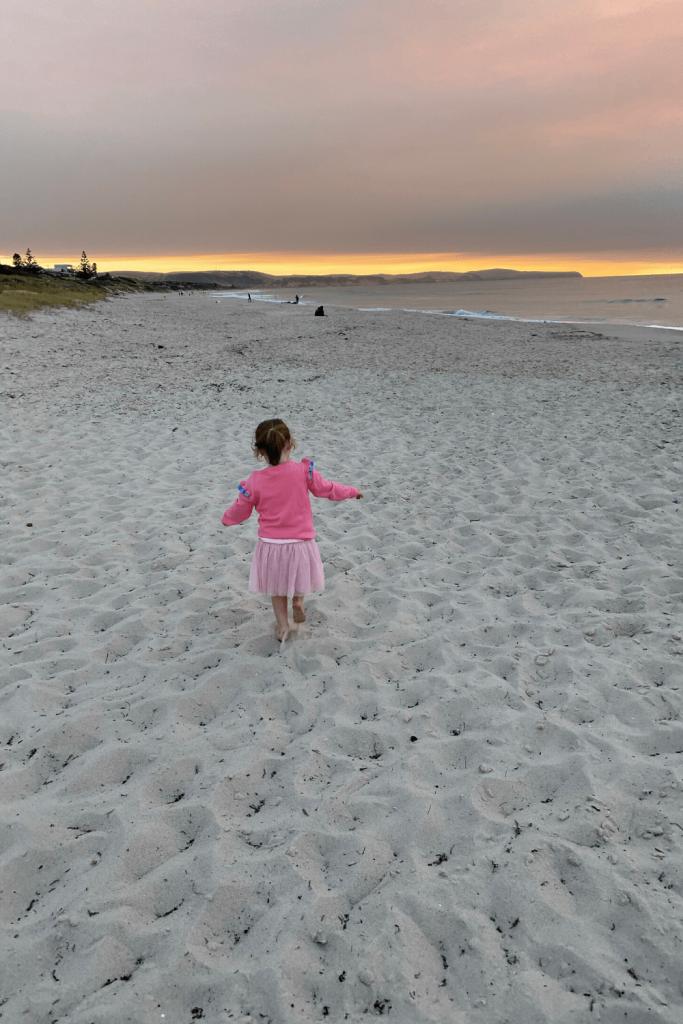 Playing on Carrickalinga Beach at sunset, Fleurieu Peninsula