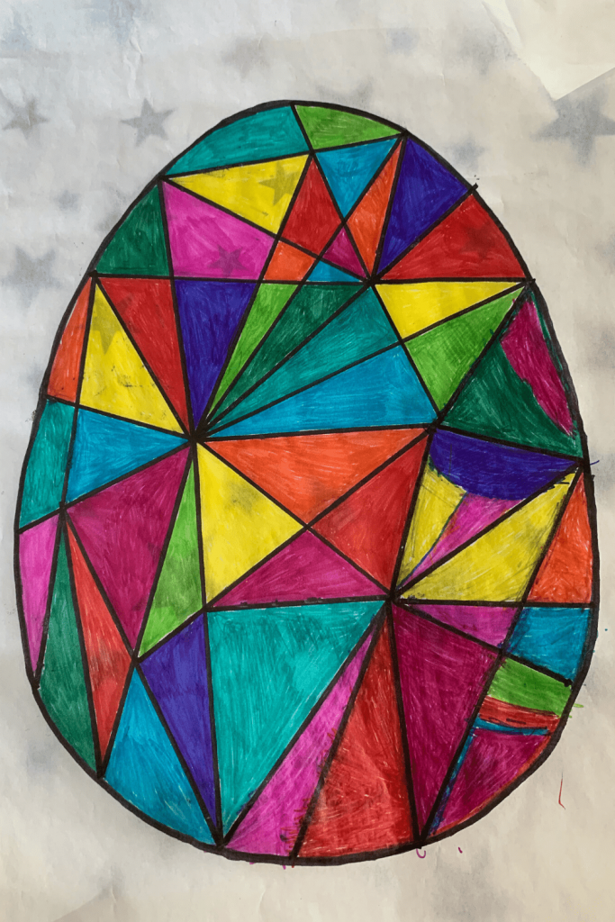 The finished faux stained glass Easter art, ready for hanging