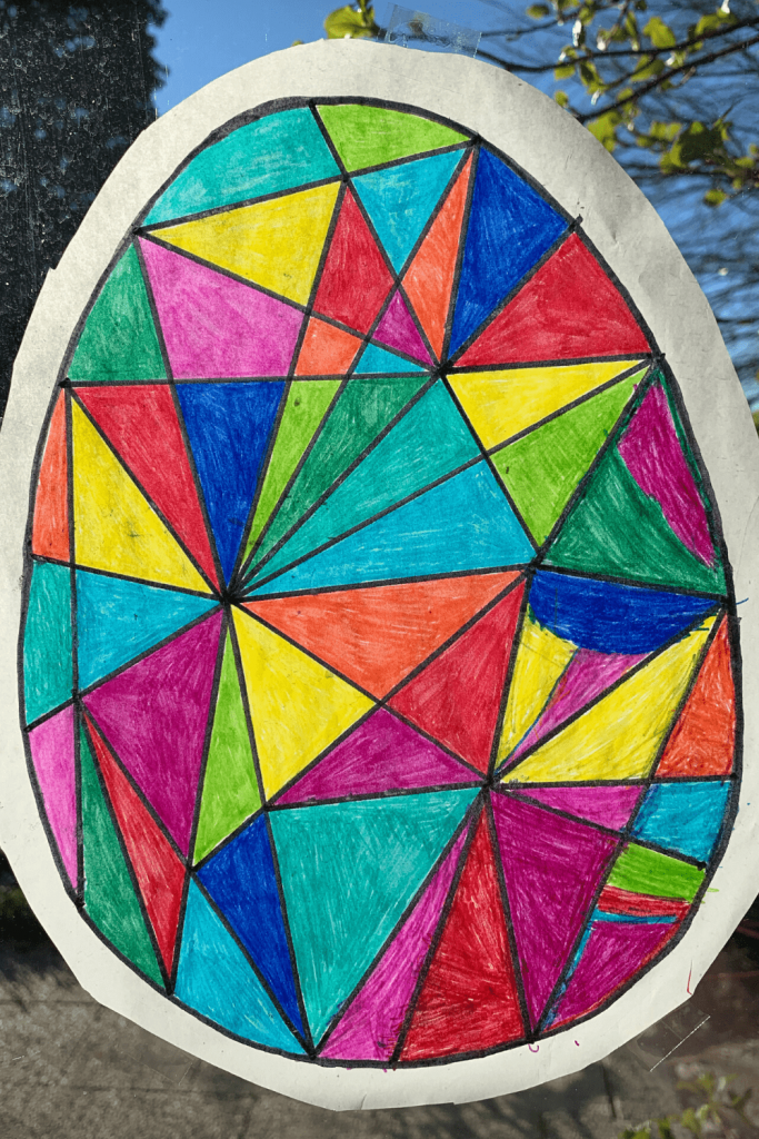 Our faux stained glass Easter art, hanging on our window