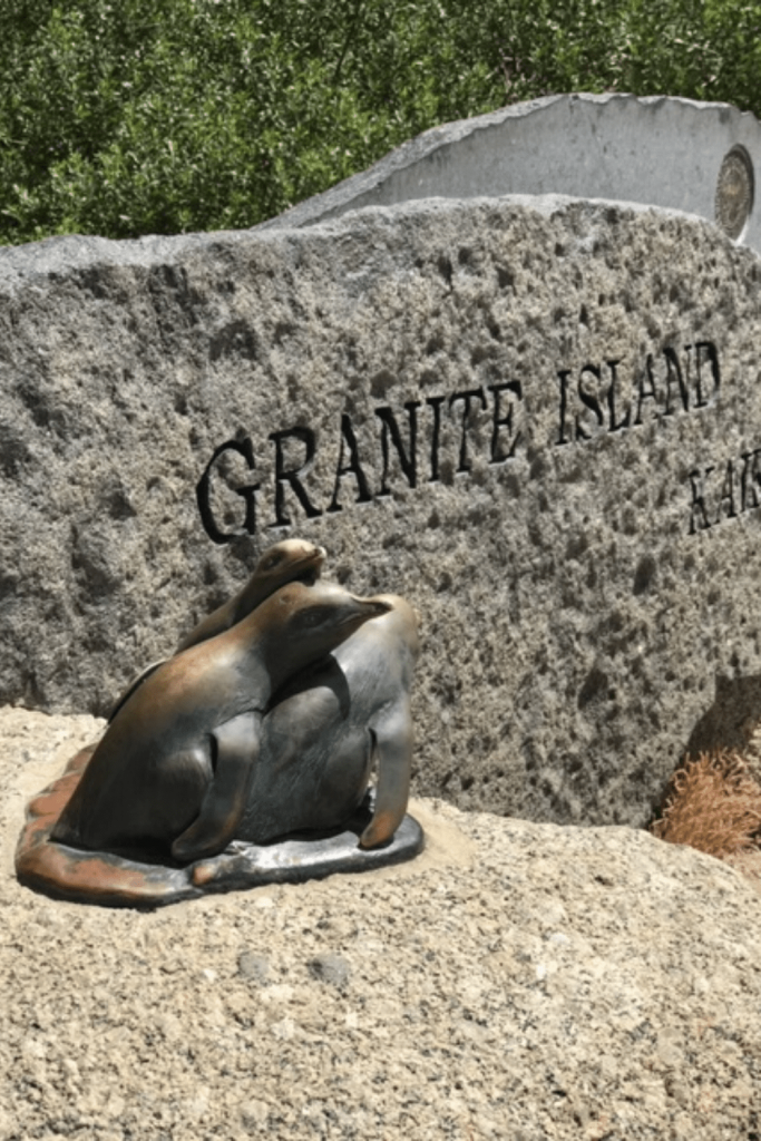 Sign welcoming visitors to Granite Island with fairy penguin sculpture, Victor Harbour, Fleurieu Peninsula