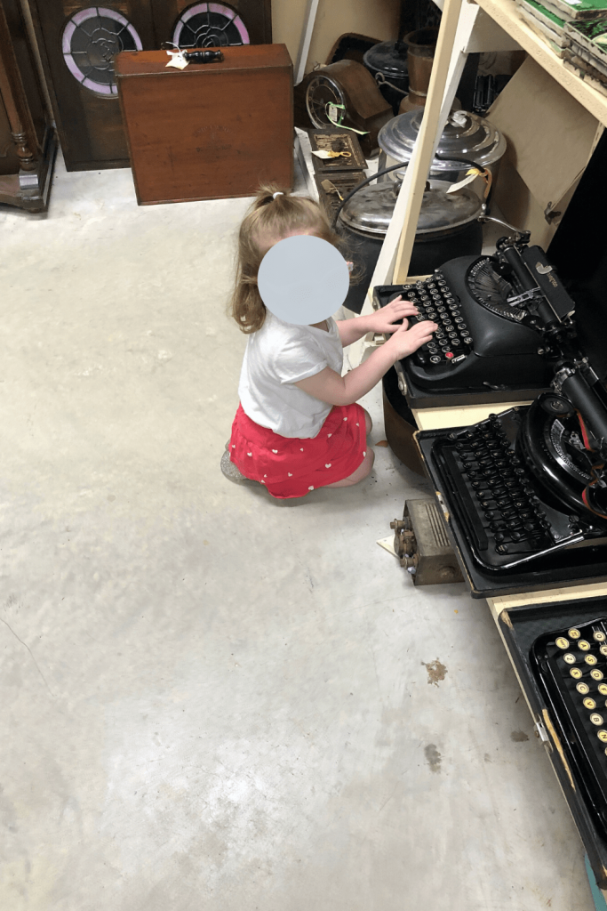 """Playing with the typewriters - """"What are these, Mummy?"""" - antique shop, Strathalbyn, Fleurieu Peninsula"""