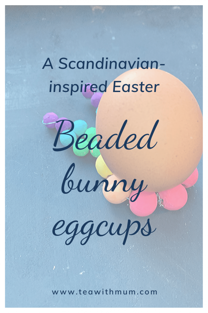 A Scandinavian-inspired Easter, with beaded Easter bunny eggcups, here with a picture of a rainbow-colored egg cup