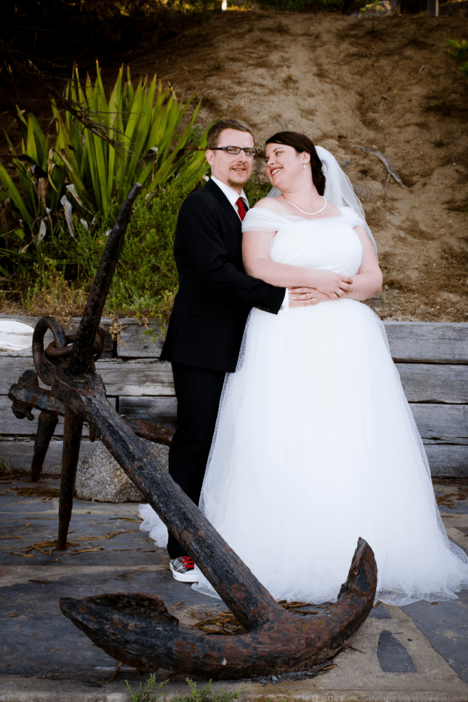 Wedding photos next to the anchors of ships that wrecked in the bay for our vintage travel themed wedding: Photo Kate Basso Photography