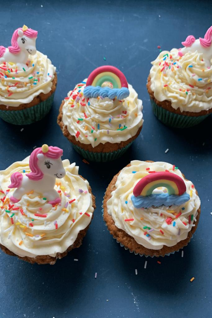 Funfetti cupcakes recipe: funfetti cupcakes with white chocolate butter cream and unicorn and rainbow sugar decorations
